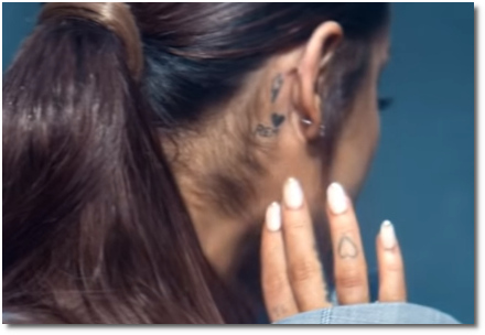 Ariana's REM tat behind her right ear (at t=2:22)