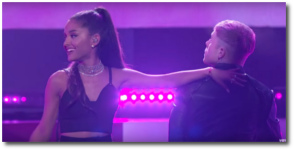 Ariana touches left but looks right and smiles while singing Into You at the BBMA 2016