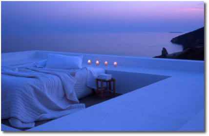 Rad bedroom with four candles, ocean and sky